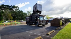 A truck empties one of the refuse bins which are being used in lieu of the drive-up bays. The relocated Pahoa Transfer Station near the top of Kauhale Street above the Pahoa Community Center. Photography by Baron Sekiya | Hawaii 24/7