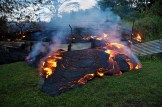Lava pushed through a fence marking a property boundary above Pāhoa early on Tuesday morning (Oct 28). Photo courtesy of USGS/HVO