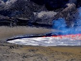 Gas in the lava lake was rapidly released during the 10:20 am explosive event, causing the lava lake surface to drop a few meters (yards). This photo was taken moments after the explosive event, and shows the overhanging ledge of lava along the rim that was exposed as the lava level dropped. Photo taken Tuesday, April 28, 2015 courtesy of USGS/HVO