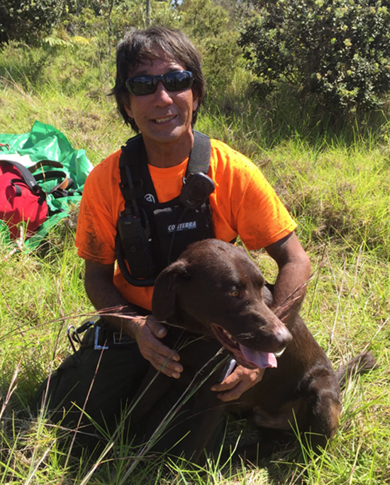 Park Ranger Arnold Nakata and rescued Romeo. (Photo courtesy of National Park Service)