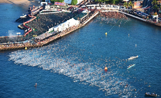 Athletes compete in the 2.4-mile/3.8km swim during the Ironman World Championship on Oct. 10 2015, Kailua Kona, Hawaii. (Photo by Delly Carr/IRONMAN)