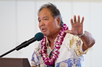 Wil Okabe talks to the audience as he represents Gov. David Ige during the dedication ceremony of the new Hilo International Airport Aircraft Rescue and Firefighting Station Friday, July 29, 2016.