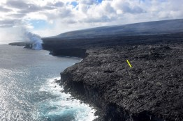 Due to the instability of the sea cliff above the ocean entry and other hazards created by molten lava flowing into the sea, Hawaiʻi Volcanoes National Park has established a viewing area (noted by yellow arrow in photo) from which the ocean entry can be seen in relative safety. Photo taken Monday, January 30, 2017 courtesy of USGS/HVO