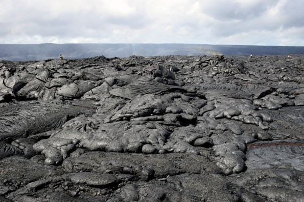 The surface breakout that started on February 10 remains active on the coastal plain just east of the main episode 61g lava flow field. The flow front, pictured here, advanced to about 300 m (0.2 miles) from the emergency access road in Hawaiʻi Volcanoes National Park, but appeared to be stalled this afternoon. However, there is still active pāhoehoe visible on the coastal plain, with the closest breakouts observed at about 500 m (0.3 miles) from the road. Photo taken Saturday, March 2, 2017 courtesy of USGS/HVO