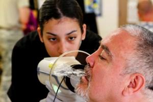 Spc. Heidy Silvia, an U.S. Army Reserve dental technician X-rays a patient's teeth during Operation Tropic Care 2017 on the Island of Kauai. U.S. Army Photo