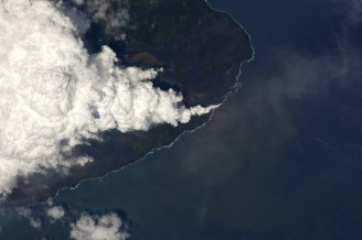 Clouds of laze billow from the ocean entry of the Kilauea Eruption at Kapoho Sunday, June 10, 2018. Photo courtesy of NASA/ISS.