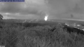 This image is from a temporary research camera positioned near Kapoho looking southwest. From left to right, one can see the eruptive fissures, with Fissure 15 on the far left, and Fissure 8 near the center. Webcam image taken Saturday, June 16, 2018 courtesy of U.S. Geological Survey