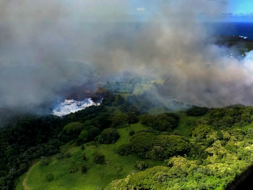 As fissure 8 lava flowed into Green Lake, the lake water boiled away, sending a white plume high into the sky—visible from afar between around 11:30 a.m. and 1:30 p.m. HST. This aerial photo, taken a couple of hours later by the Hawai'i County Fire Department, shows still-steaming lava within Green Lake, located near the intersection of Highways 132 and 137. Photo taken Saturday, June 2, 2018 courtesy of U.S. Geological Survey