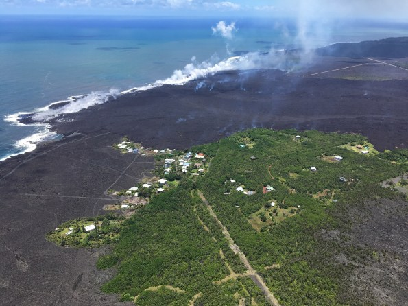 How do you keep people safe when lava is rapidly advancing through communities? This was just one of the topics addressed during the Cities on Volcanoes 10 meeting in Naples, Italy, last week. Lava flows recently erupted from Kīlauea Volcano's lower East Rift Zone inundated hundreds of homes in the lower Puna District of Hawaiʻi Island. Here, lava enters the Pacific Ocean south of the remaining homes in Kapoho Beach Lots subdivision on June 6, 2018. USGS photo by M. Patrick.