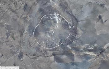 This August 11, 2018, aerial photomosaic of Kīlauea Volcano's south caldera shows how the summit was changed by the collapse events that occurred between the end of May and August 2. The bright white line circles the outline of Halema'uma'u as it was before the onset of the 2018 collapses. Closer views of the fuming spots within the collapsed area are shown in the two photos posted below. Note in the lower third of this image the section of Hawai'i Volcanoes National Park's Crater Rim Drive (light gray line) that dropped into the crater during the collapse events. Photo taken August 11, 2018 courtesy of U.S. Geological Survey