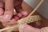 Weaving a lauhala bracelet. NPS Photo