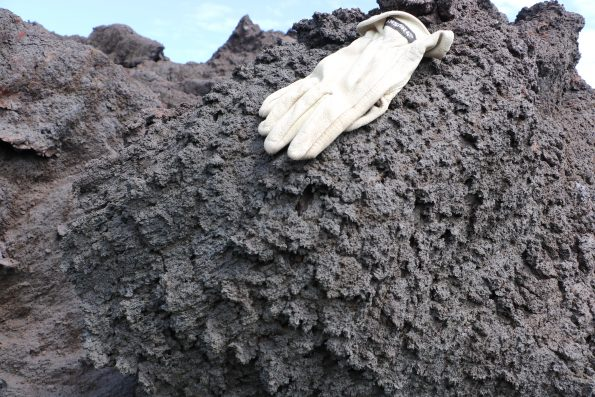 "A closer view of the ""toothpaste lava"" (glove for scale) spiny texture, which can result in serious injury if people fall while attempting to walk on it. Because folks have already been hurt, the County advises people to avoid this hazard by staying off the lava flow. USGS photo by M. Patrick."