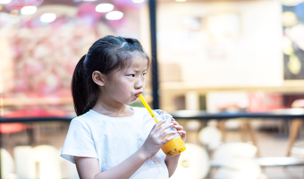"""Learn the truth behind kids' """"fruit"""" drinks and see if your child is compromising their oral and overall health with their sugary drink consumption."""