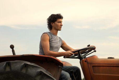 Man riding a tractor - Organic Farms Hawaii