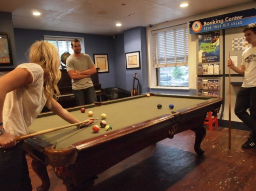 People playing pool at Oahu Hostels