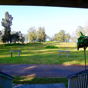 Ranch house entry looking out over pasture and trees