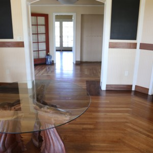 Ranch house interior with carved wood horsehead table