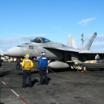 FA 18 Hornet being readied on the USS Ronald Reagan