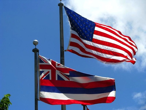 U.S. and Hawaii flags flying together.