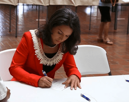 Congresswoman Tulsi Gabbard takes advantage of early voting in 2012. Those voting by mail should receive their ballot within 7 days of requesting one