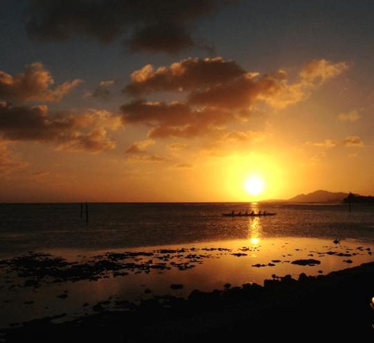 Canoe paddlers cross Maunalua Bay at Sunset