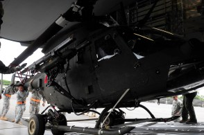 Soldiers from 2nd Squadron, 6th Cavalry Regiment, 25th Combat Aviation Brigade load an OH-58D Kiowa Warrior in the back of an Air Force C-17 Globemaster III during a static load training session on Joint Base Pearl Harbor-Hickam, Hawaii, June 7.