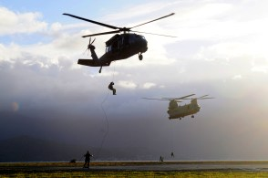A UH-60 Black Hawk with Company B, 2nd Battalion, 25th Aviation Regiment, 25th Combat Aviation Brigade and a CH-47F Chinook with B Co., 3rd Battalion, 25th Aviation Regiment, 25th CAB conduct rappel operations with Navy divers from the U.S. Navy SEAL Delivery Vehicle Team 1, Naval Special Warfare Group 3 during rappel training with flight crews from the 25th CAB at Marine Corps Air Station Kaneohe Bay June 18.