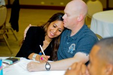 Sergeant Mathew Gray, the training noncommissioned officer for Troop E, 2nd Squadron, 6th Cavalry Regiment, 25th Combat Aviation Brigade, enjoys time with his wife Minerva as they fill out a questionnaire on the Five Love Languages while attending the 25th CAB Strong Bonds Marriage Retreat at the Hale Koa Hotel in Honolulu June 27.