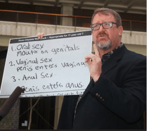 NOT THE THREE R'S: McDermott holds up a copy of notes from an 11-year-old student enrolled in the sex education classes in the state's public schools. (file photo)