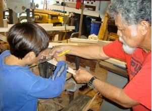 Bobby Puakea teaches people of all ages how to make their own canoe paddles