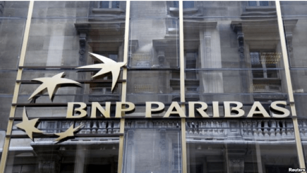 FILE - The logo of BNP Paribas is seen on the bank's building in Paris, May 30, 2014. FILE - The logo of BNP Paribas is seen on the bank's building in Paris, May 30, 2014.