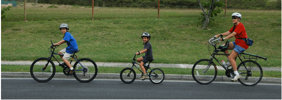 Natalie Iwasa and her children bike through East Oahu