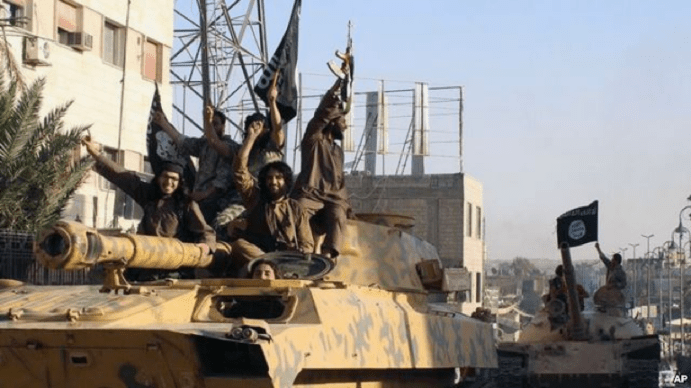 In undated image posted by Raqqa Media Center, Islamic State militants parade in Raqqa, Syria, June 30, 2014.
