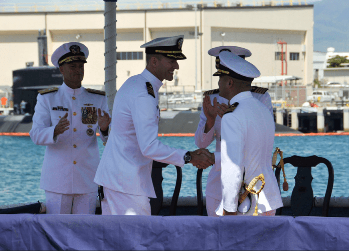 PEARL HARBOR, Hawaii - (Aug. 26, 2014) - Commander David Youtt, left, passes on command of the Los Angeles-class fast attack submarine USS Columbus (SSN 762) to Cmdr. Albert Alarcon at a change of command ceremony, Aug. 26. (U.S. Navy Photo by Mass Communication Specialist 1st Class Steven Khor/Released)