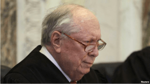 FILE - Judge Stephen Reinhardt listens to arguments during hearing on California's Proposition 8 at the 9th District Court of Appeals in San Francisco.