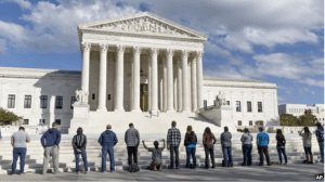 As the Supreme Court begins its new term this week, pro-life advocates hold a prayer vigil on the plaza of the High Court in Washington, Oct. 4, 2014.