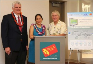 Chief Justice Mark Recktenwald (left), M.Nalani Fujimori Kaina (center), Executive Director of Legal Aid Society of Hawaii, and State Librarian Richard Burns (right) introducing software that helps expand access to the courts in libraries statewide.