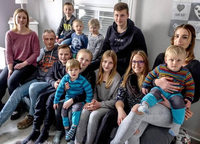 German mother of 11 kids fights virus with discipline, love
