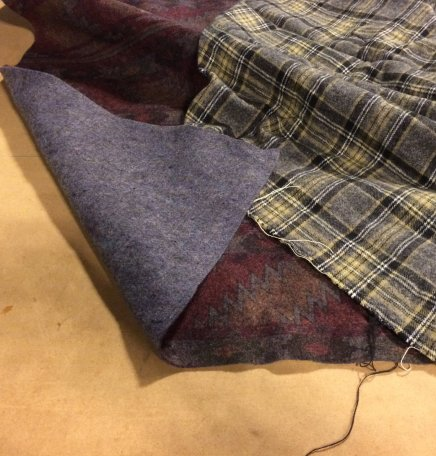 flannel + closeout upholstery felt = cozy and cheap porch decor blankets
