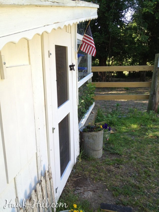 Chicken Coop with tiny american flag
