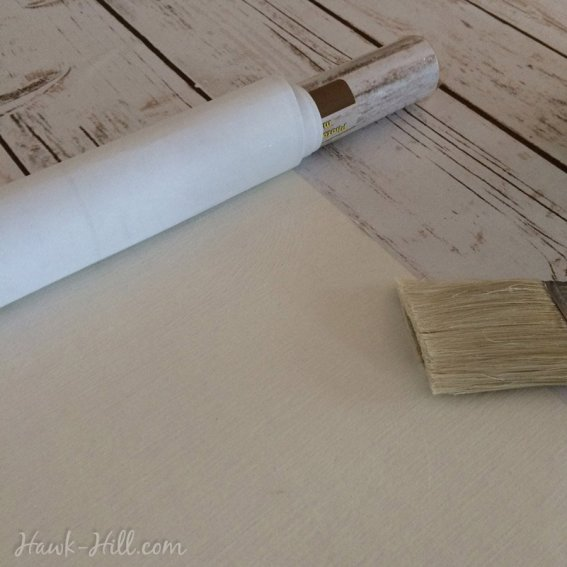 Blog tutorial on how to use cheap photo backdrop paper to create easy, seamless faux rustic barn wood. - Hawk-Hill.com