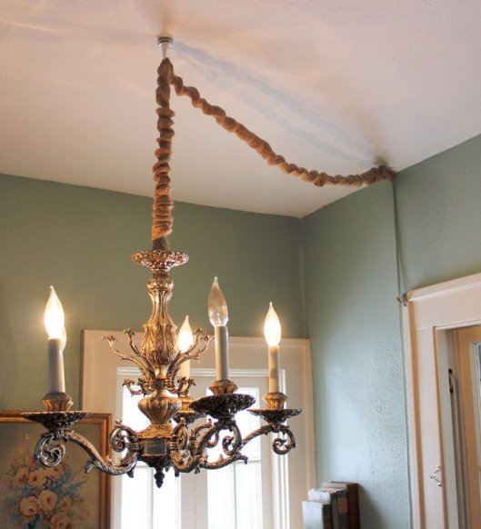 Hang a Chandelier without hardwiring by converting to a lamp and then covering the cord.