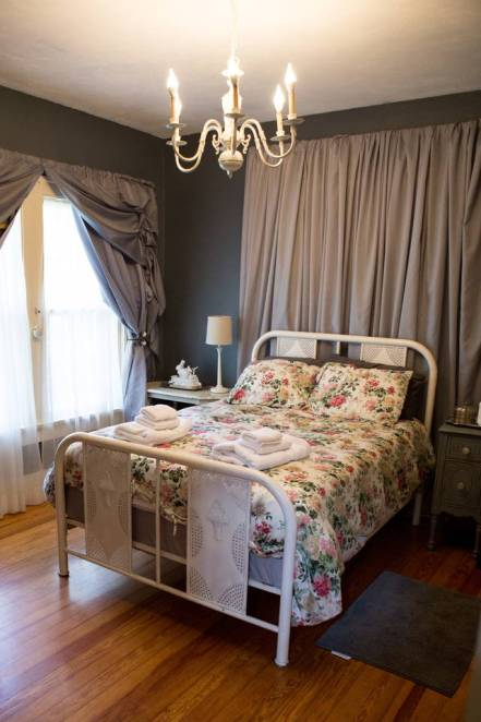 bed in front of a hidden window