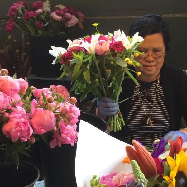 Woman Making a boquet at Pike Place Market