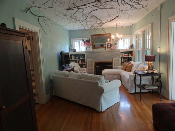 living room with branches on ceiling