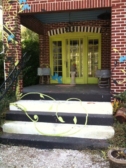 Lime green painted vintage front door on a brick house