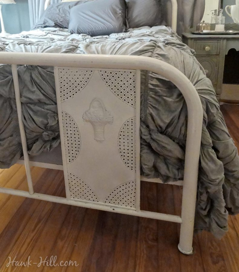 anthropologie rosette quilt paired with feminine vintage metal bedframe in my master bedroom