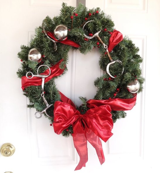 christmas wreath with bit and spurs added for stable or barn decorations