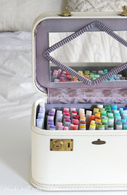 Using a vintage train case for art supply marker storage