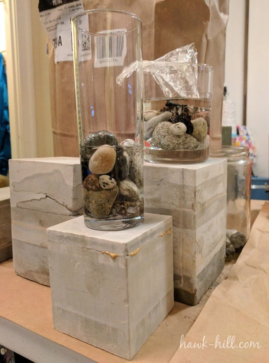 This photo shows a midpoint in my project. Vessels with sealed stones have a layer of resin poured and cured, then dimensional pieces of resin are added and secured in place with a second flat-pour of resin.